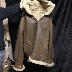 Leather coat with shearling lining